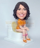 Lady on toilet bobblehead