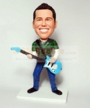 custom bobblehead doll-playing bass guitar