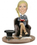 Reading girl bobbleheads