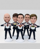 Superman bobbleheads as groomsmen