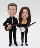 Playing guitar couple bobbleheads