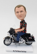 Custom bobbleheads riding on Harley Davidson Motorbike