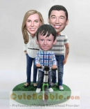 A family of three fully custom bobbleheads