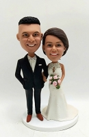 Custom bobblehead-wedding cake topper