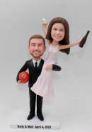 Bride sits on groom's shoulder bobblehead