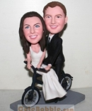 Riding Bicycle Bobblehead Wedding Cake Toppers