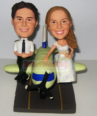 Pilot bobblehead cake toppers with plane