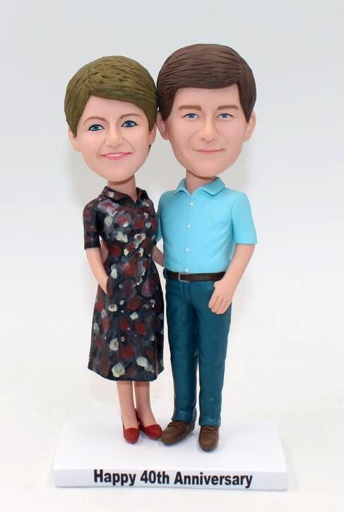 Anniversary bobbleheads made from old photos